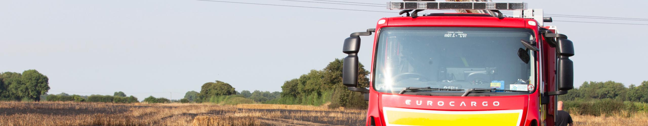 Kent Fire & Rescue Service fire engine in a field