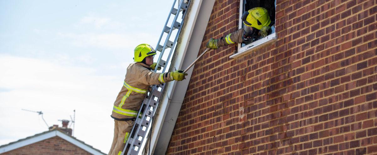 Kent Fire & Rescue fire man on ladder