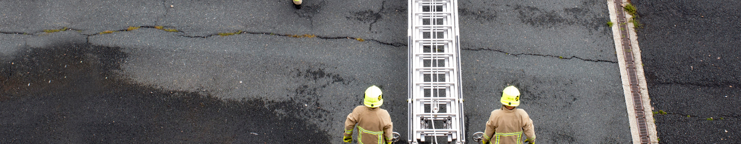 Kent Fire & Rescue firemen carrying ladder