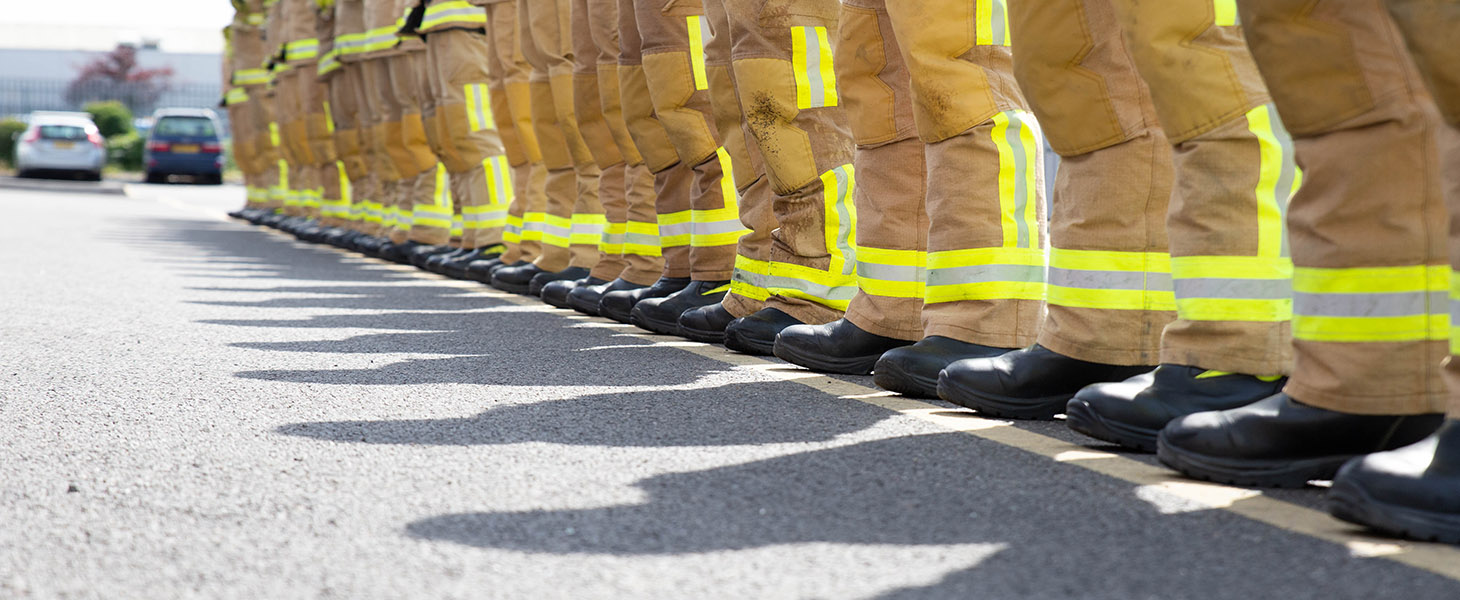 Fire crew line up from low angle of boots