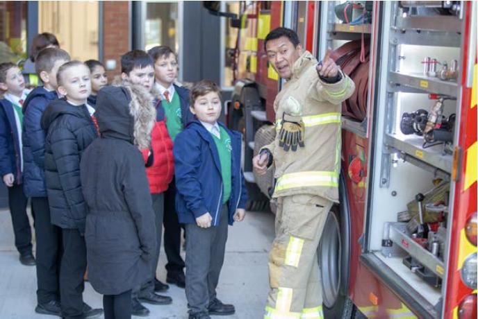 Kent Fire & Rescue fireman teaching children