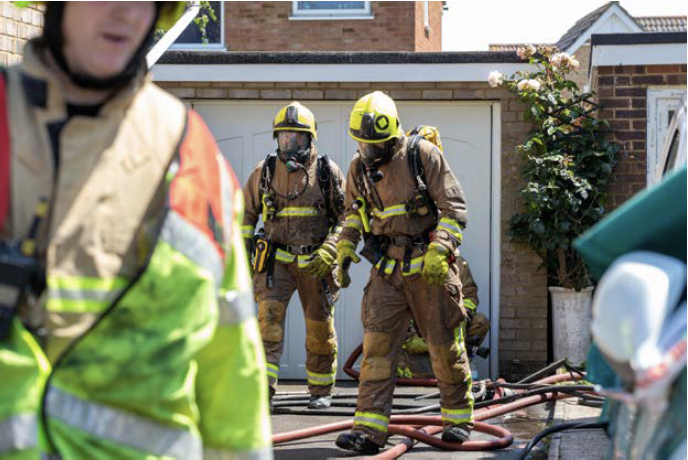 Kent Fire & Rescue fire officers at a residence