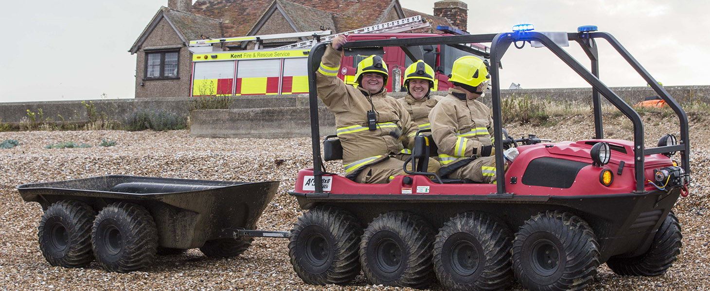 Cross terrain vehicle one beach with three firefighters on-board